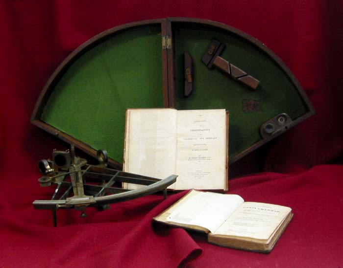 Sextant and books